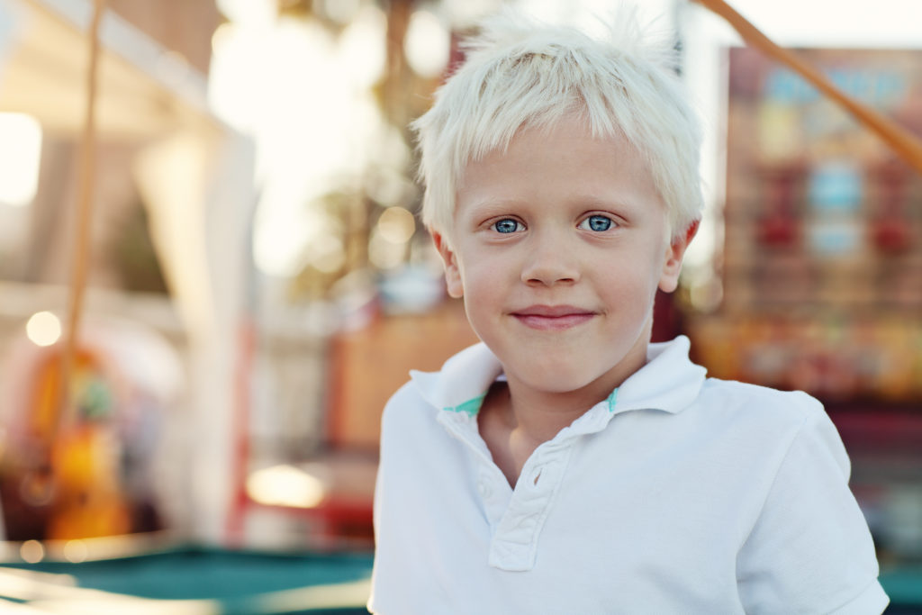 young boy smiling with blonde hair