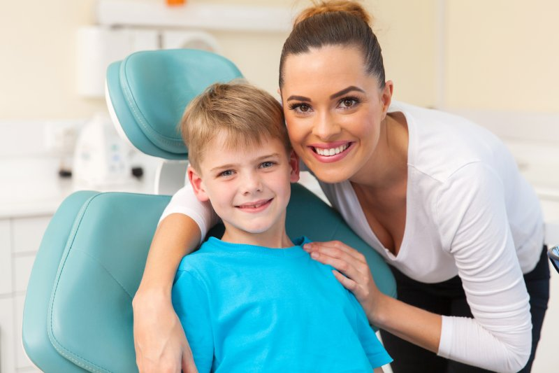 mother and child smiling at dentist